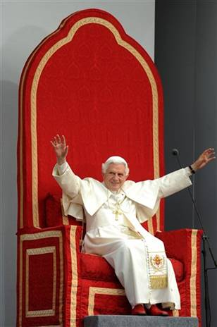 Pope on big red chiar